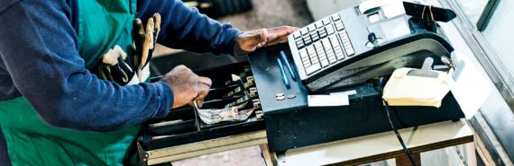 man using cash register