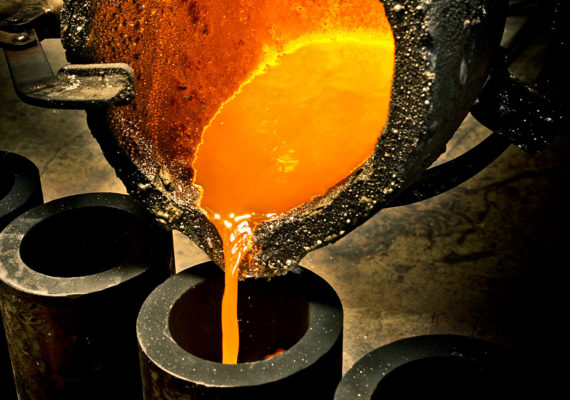 molten metal being poured into mold