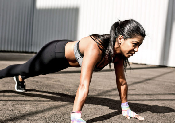 woman does plank exercise
