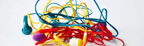 tangled headphones on white