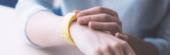 yellow bracelet on wrist