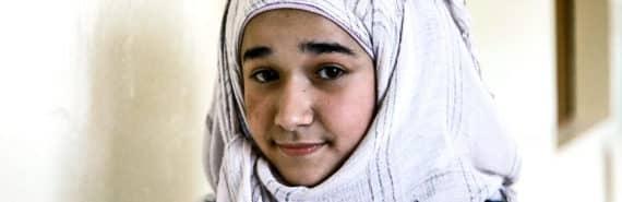 Syrian girl in hallway