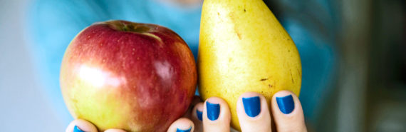 hands with blue nails hold apple and pear