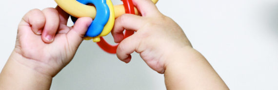 baby hands with toy