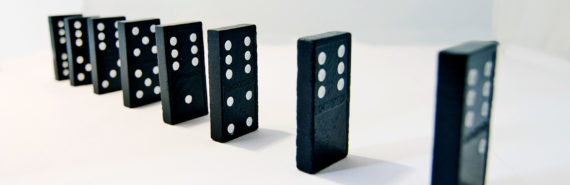 black dominoes standing in a row