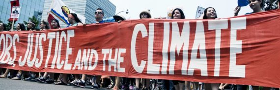 climate protesters holding banner