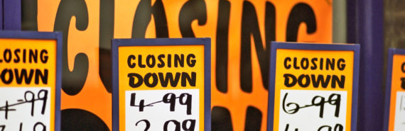 "orange ""closing down"" sale signs"