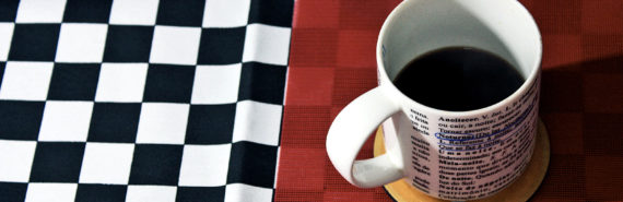 coffee cup on checkerboard table cloth
