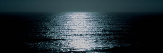 light on dark ocean
