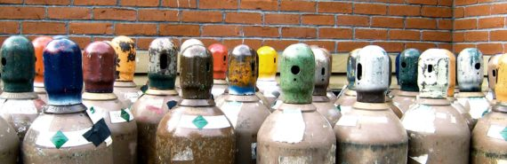 gas containers against brick wall