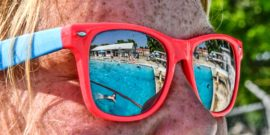 pool reflected in red sunglasses
