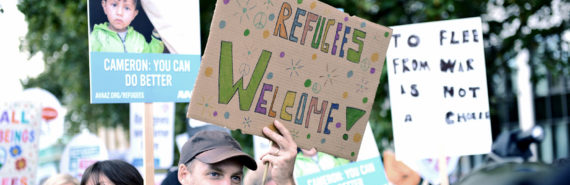 protesters in London welcoming refugees
