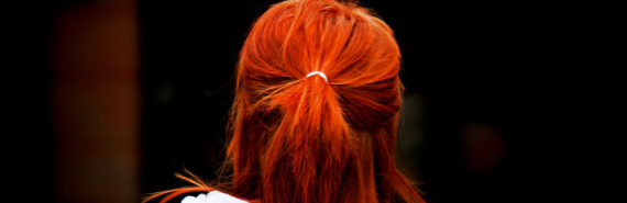 girl's hair is bright orange