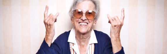 "elderly woman signs ""rock on"""