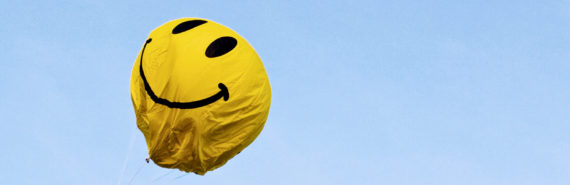 yellow smiley balloon looks deflated