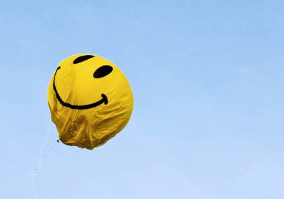 yellow smiley balloon looks deflated
