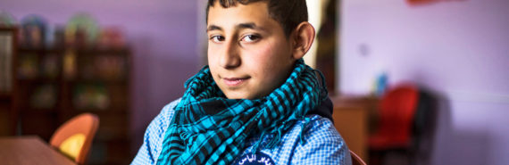 syrian teen boy at desk