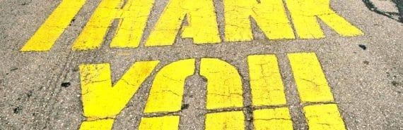 thank you written on asphalt
