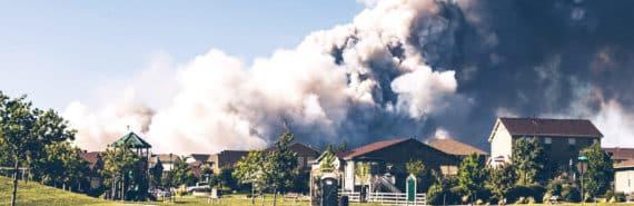 wildfire smoke behind neighborhood