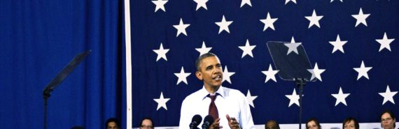Barack Obama speaking in front of flag