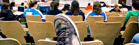 foot on chair in lecture class