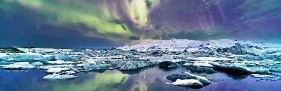 glacier under aurora borealis