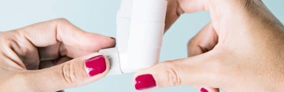 hands holding inhaler