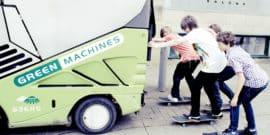 kids on skateboards hitch a ride