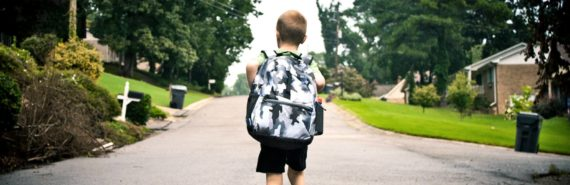 kid walking to school with backpack