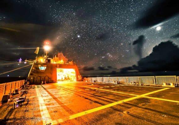Naval ship under stars at night