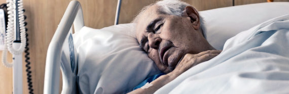 older man sleeping in hospital bed