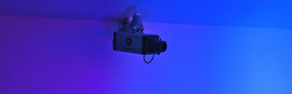 security camera in blue/purple room
