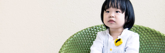 toddler in green chair