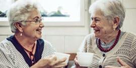two elderly women have tea