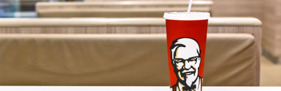 red KFC cup with face on it