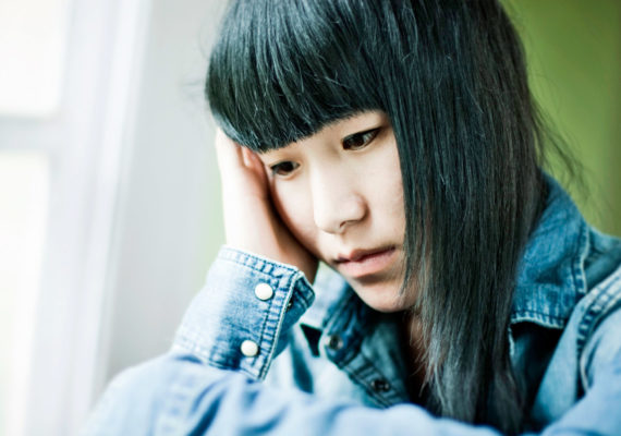 anxious girl with black hair, denim shirt