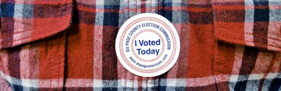 flannel shirt with 'I voted' sticker