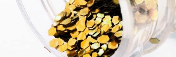 gold glitter bits in a bottle
