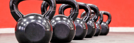 kettlebells on red