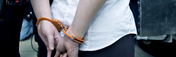 orange handcuffs on woman