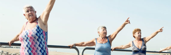 older women exercise on a pier
