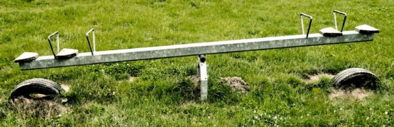 metal seesaw and grass
