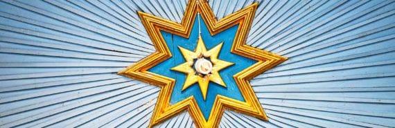 star decoration around lightbulb