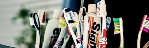 toothbrushes near the sink