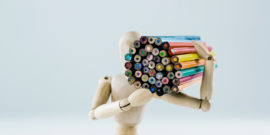 wooden model holding color pencils