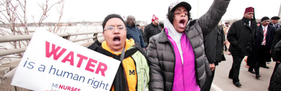 two women walk in Flint protest