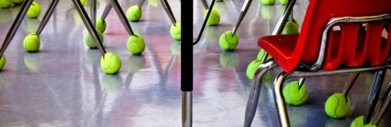 tennis balls on red classroom chairs