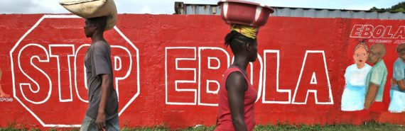 "people walk past ""stop ebola"" mural"