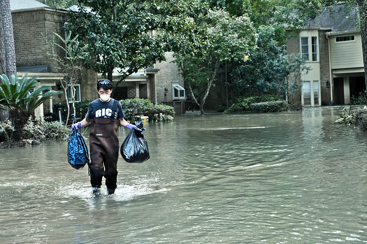 carrying bags through flooding