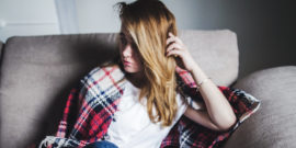 teen girl with plaid blanket